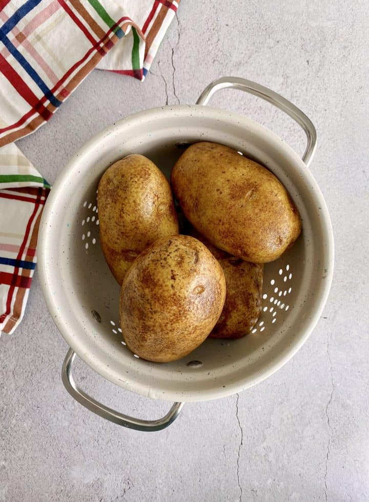 potatoes in a colander with napkin on side