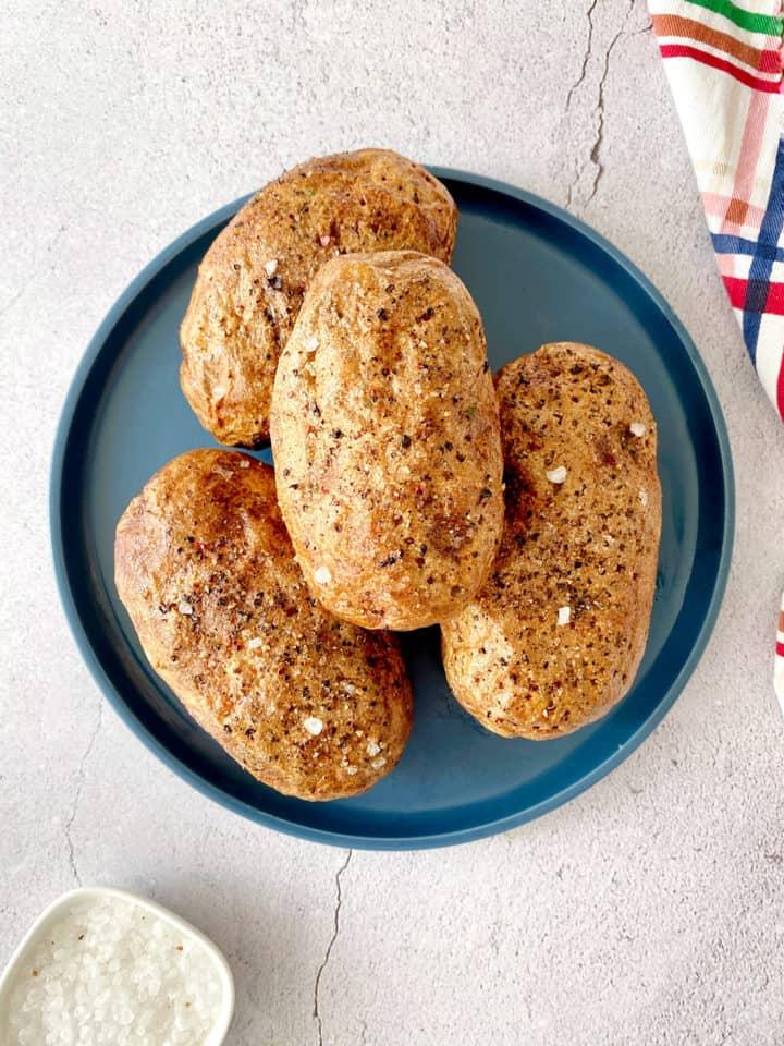 4 baked potato on a plate