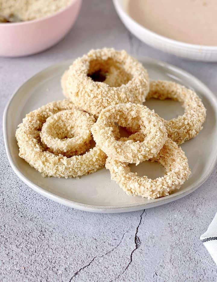 battered onion rings on a plate