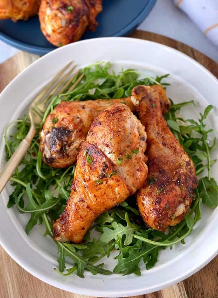 air fryer chicken on a bed of arugula