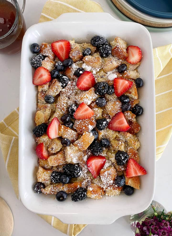 baked french toast in a casserole dish with berries