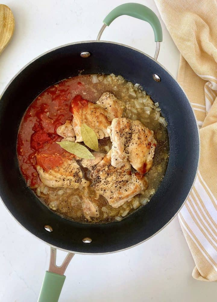 pot with tomato paste, chicken onions
