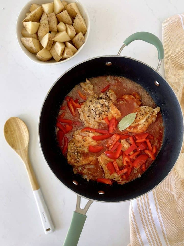dutch oven with bell peppers,potatoes and chicken