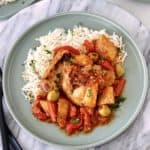 plate of chicken afritada over rice