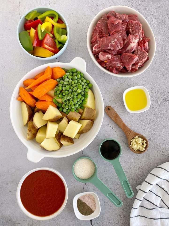 bowls of ingredients for beef stew