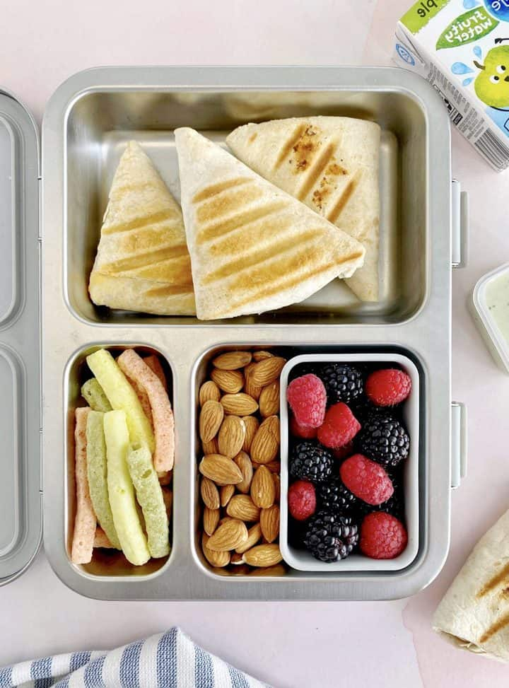 lunch box with tortilla wrap and snacks