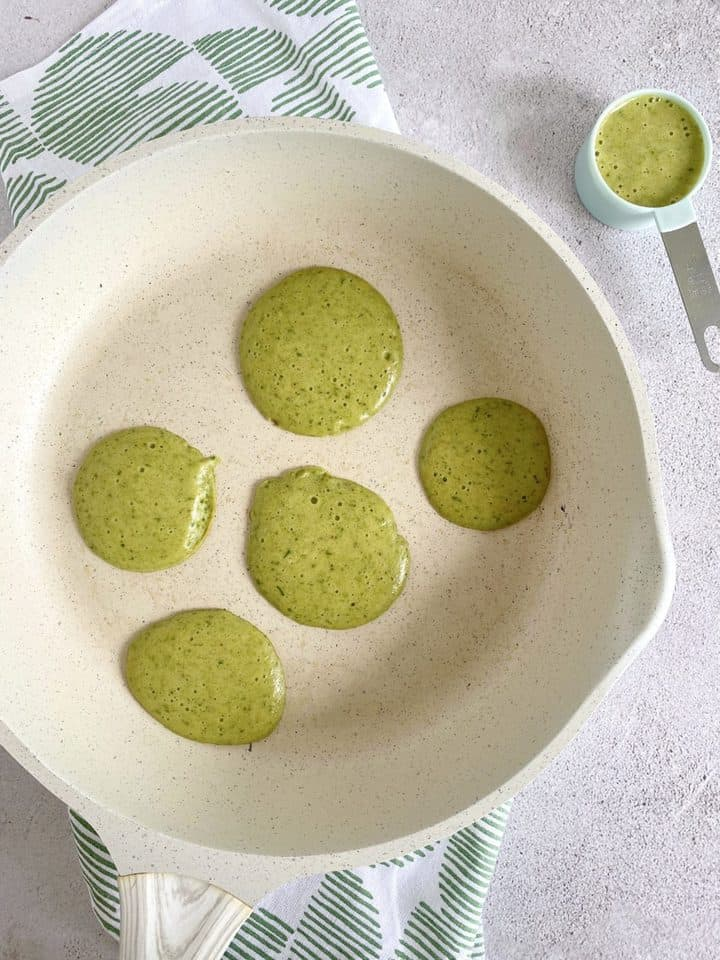 pan with green circles of batter