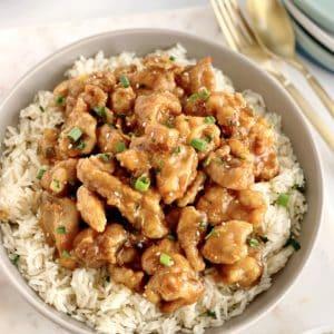 bowl of orange chicken on rice