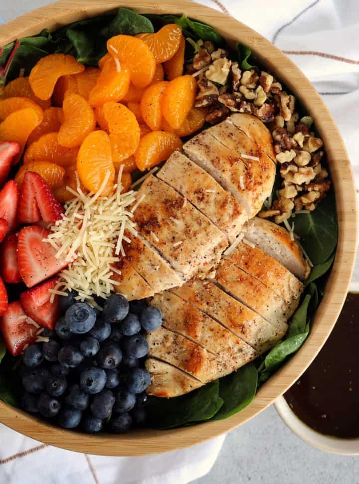 bowl of salad including chicken, mandarin oranges,