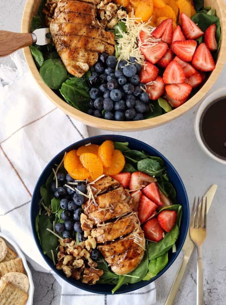 bowls of salad with fruits and chickne