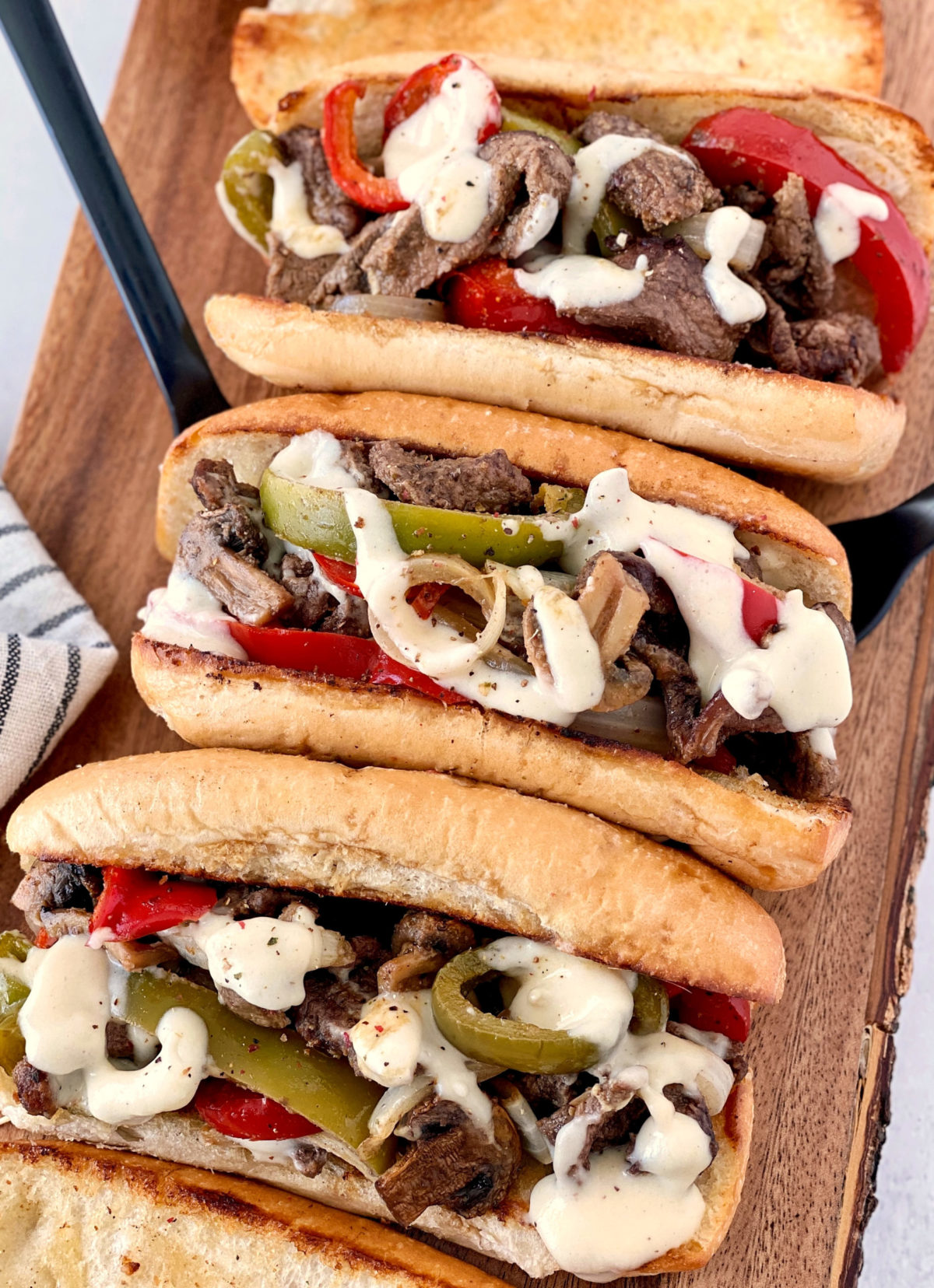 philly cheesesteak on a wooden board