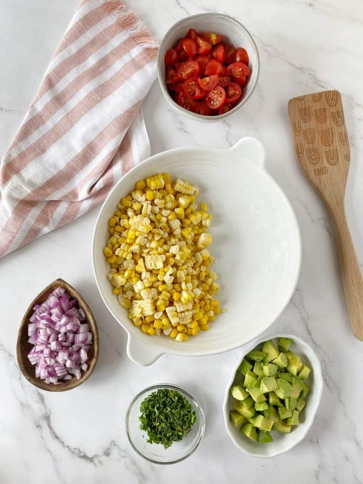 bowls of ingredients for corn salad