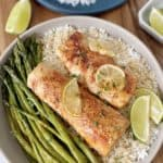 plate with rice and asparagus with lime on i