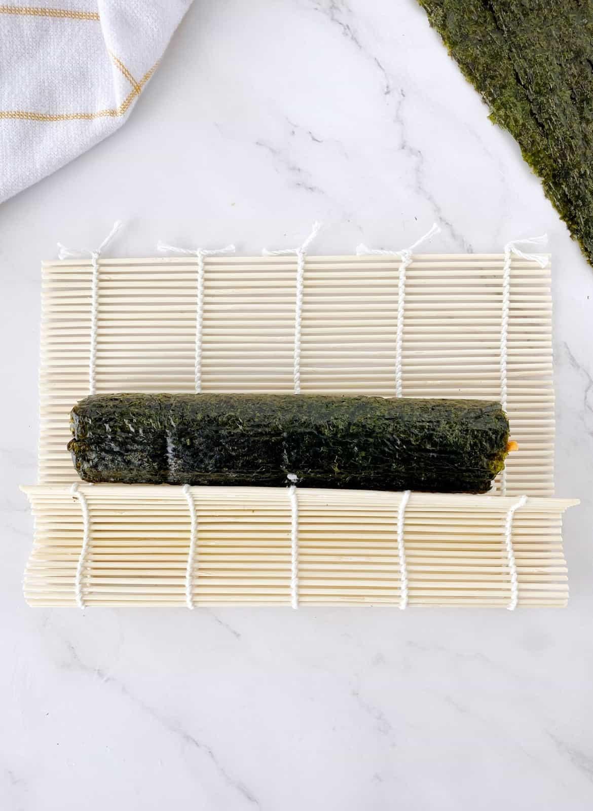 sewaweed roll on a sushi mat