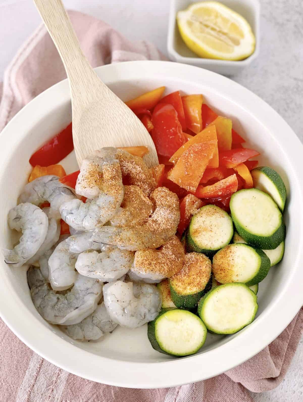 bowl of shrimp and vegetables with cajun seasoning
