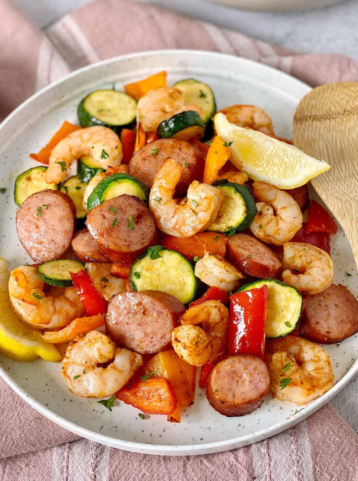 bowl of cajun shrimp and veggies with sausage