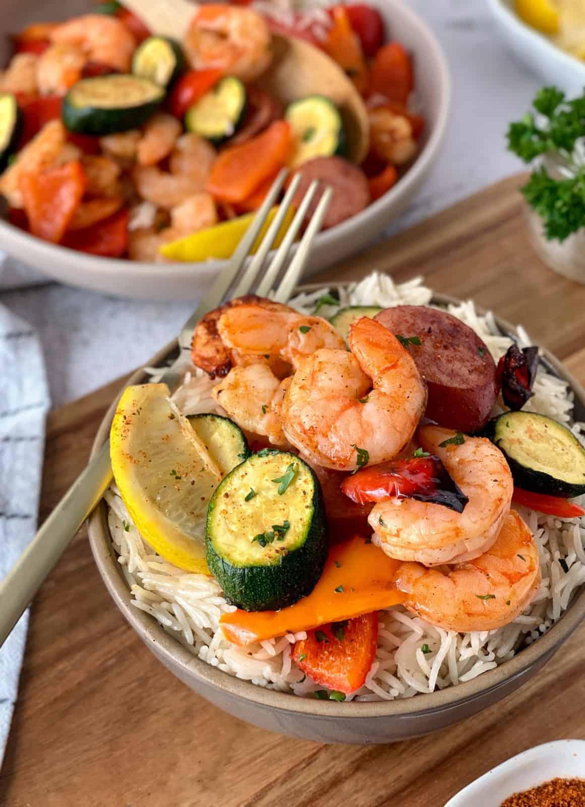 bowls cajun shrimp and veggies with sausage