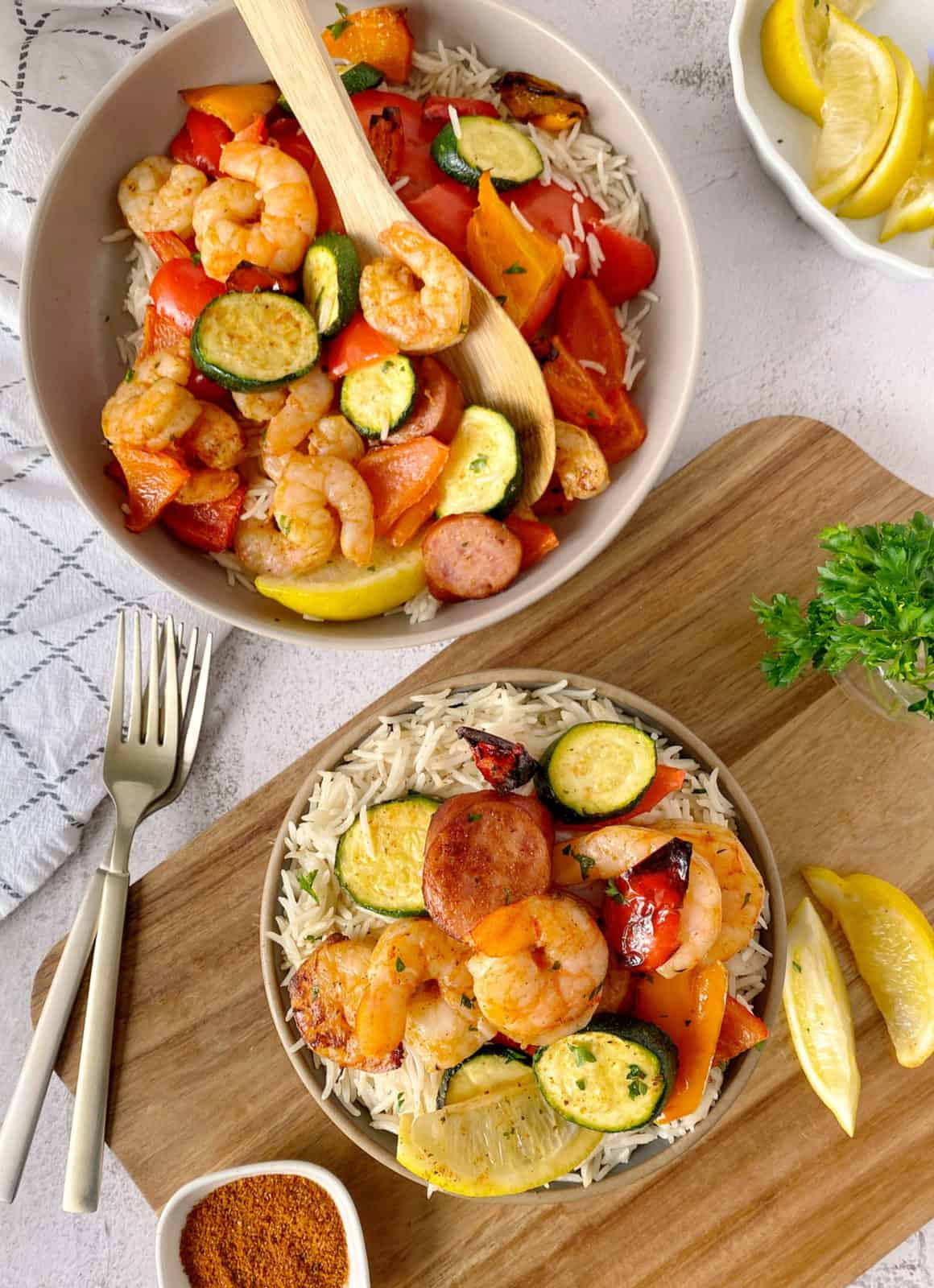 bowl of shrimp and veggies next to vowl of shrimip and veggies on top of rice