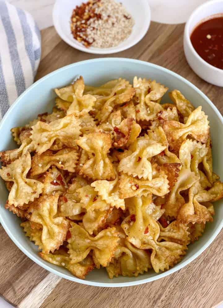 bowl of pasta chips with dip on the side