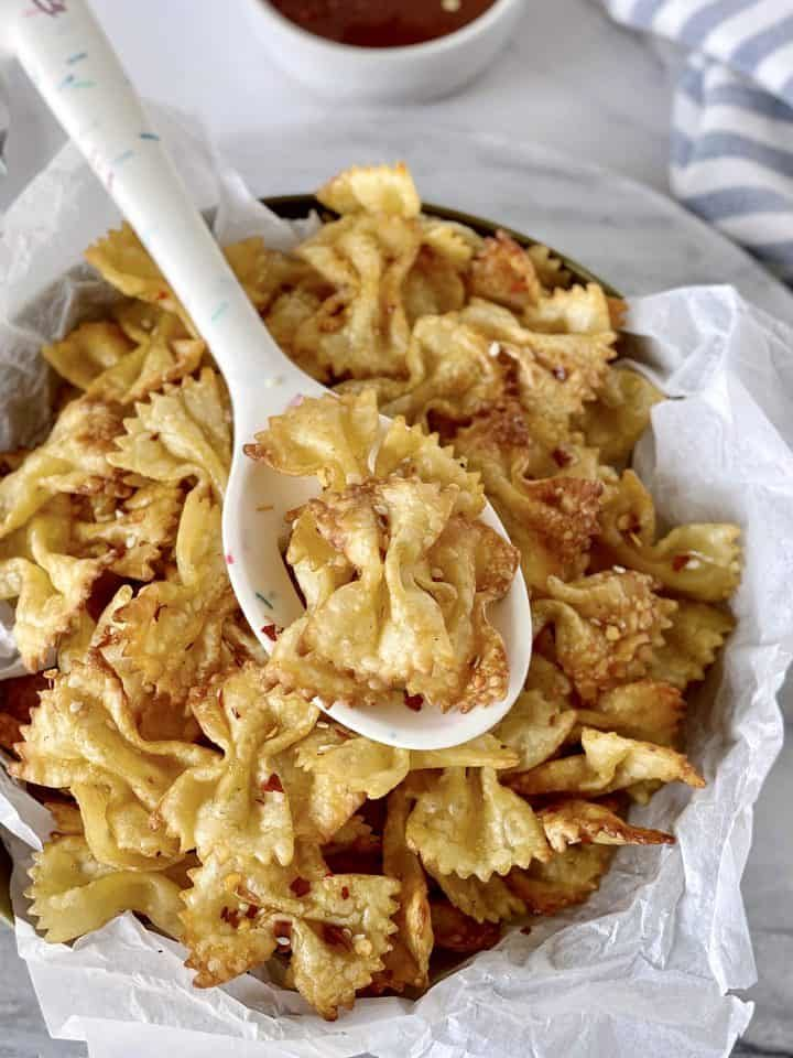 bowl of pasta chips with spoon