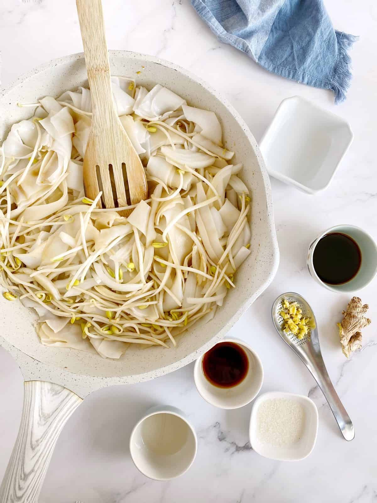 pan of noodles with seasonings ready to be added
