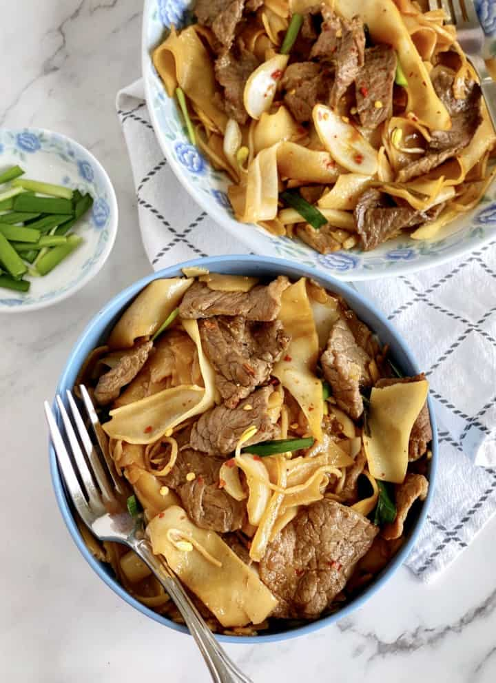 two bowls of beef chow fun