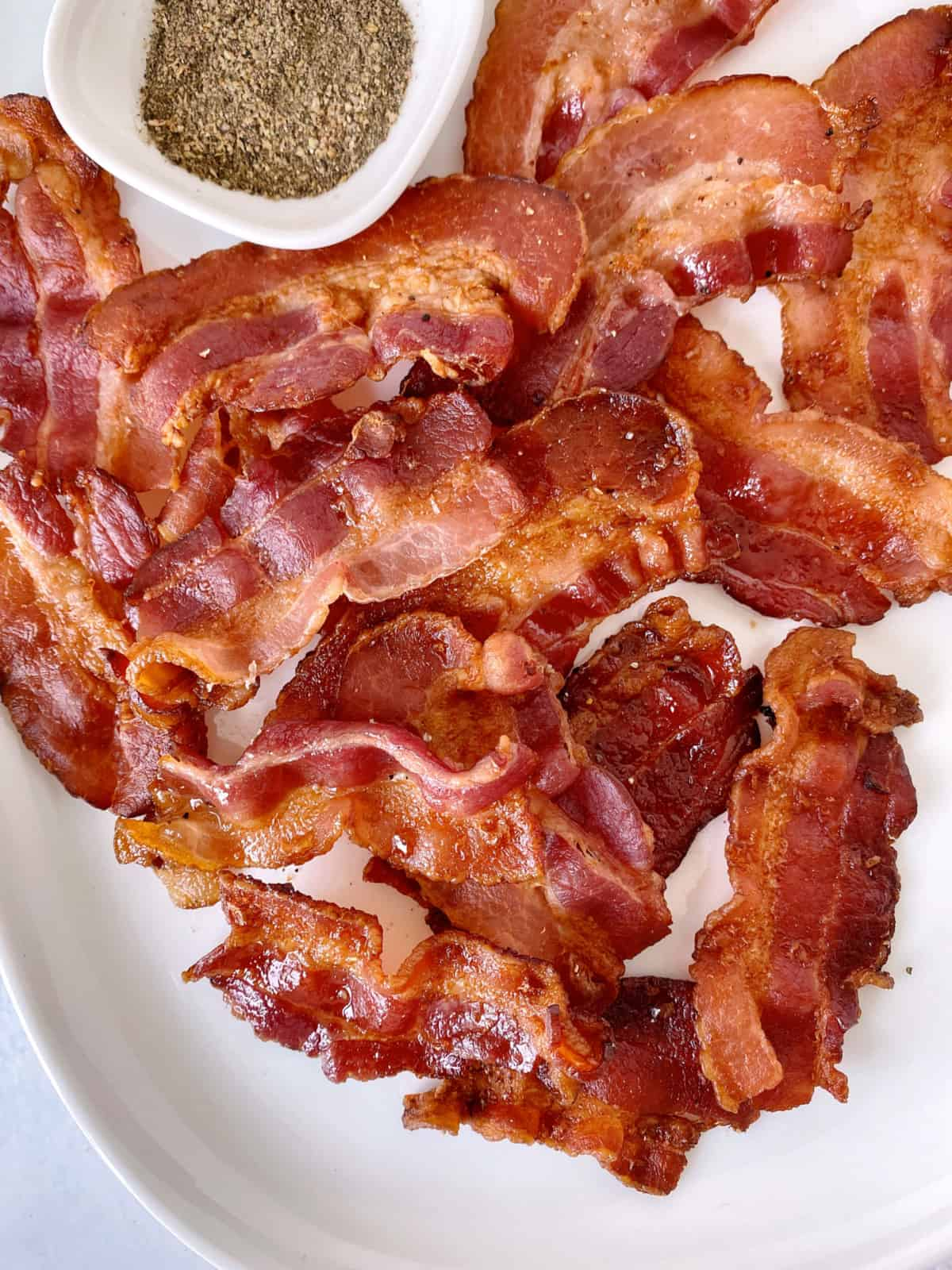 close up of air fryer bacon on a plate