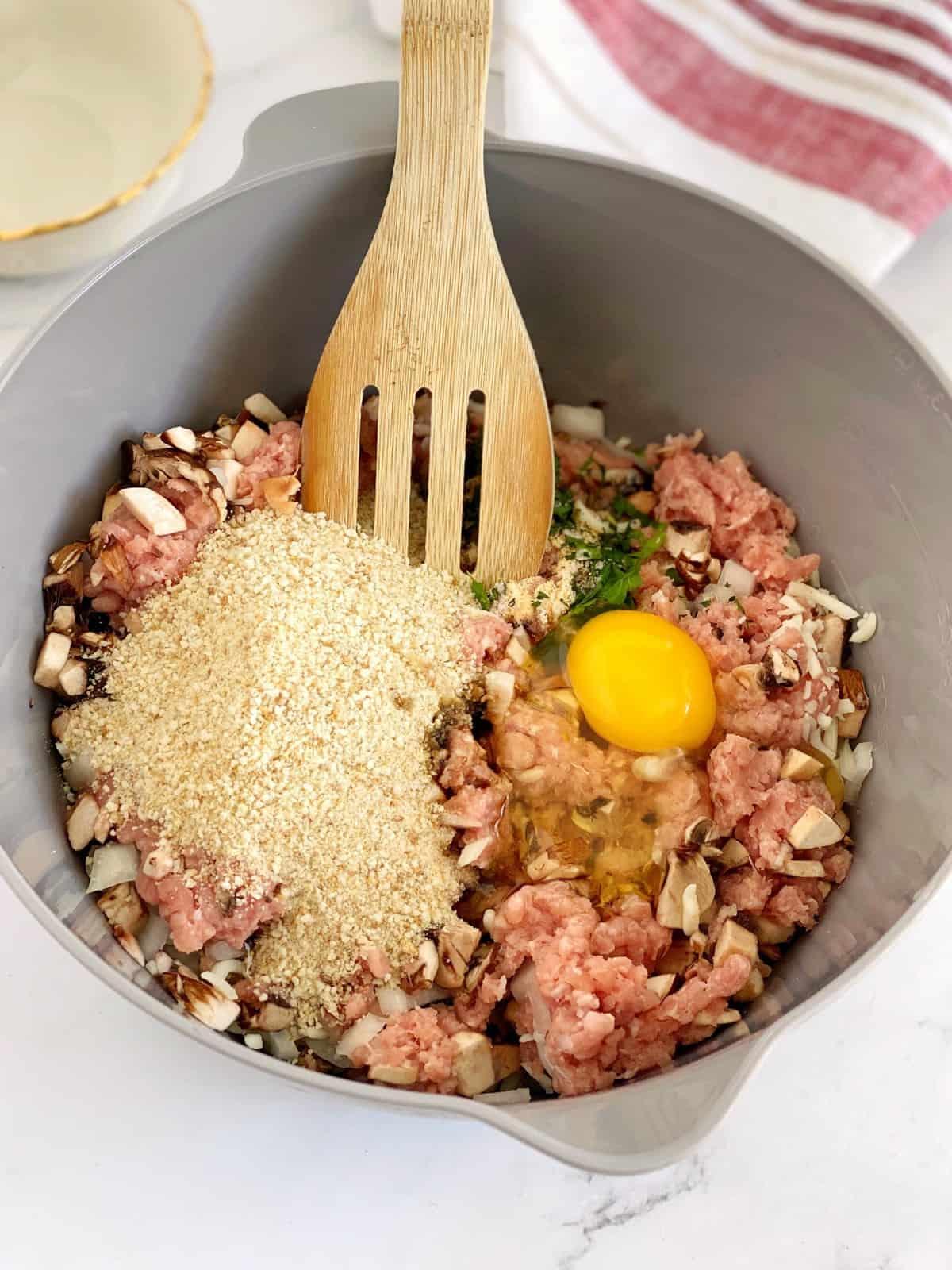 bowl of ground turkey egg and seasonings
