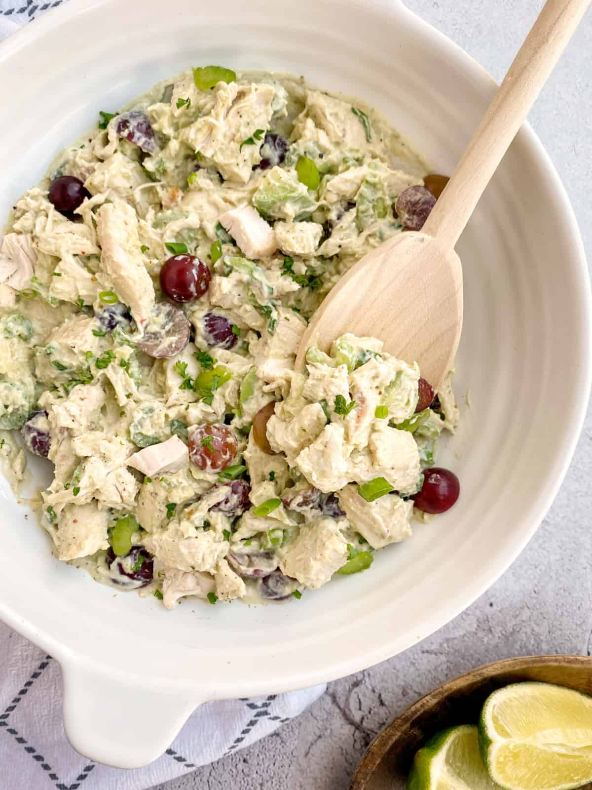 chicken avocado salad with woode n spoon