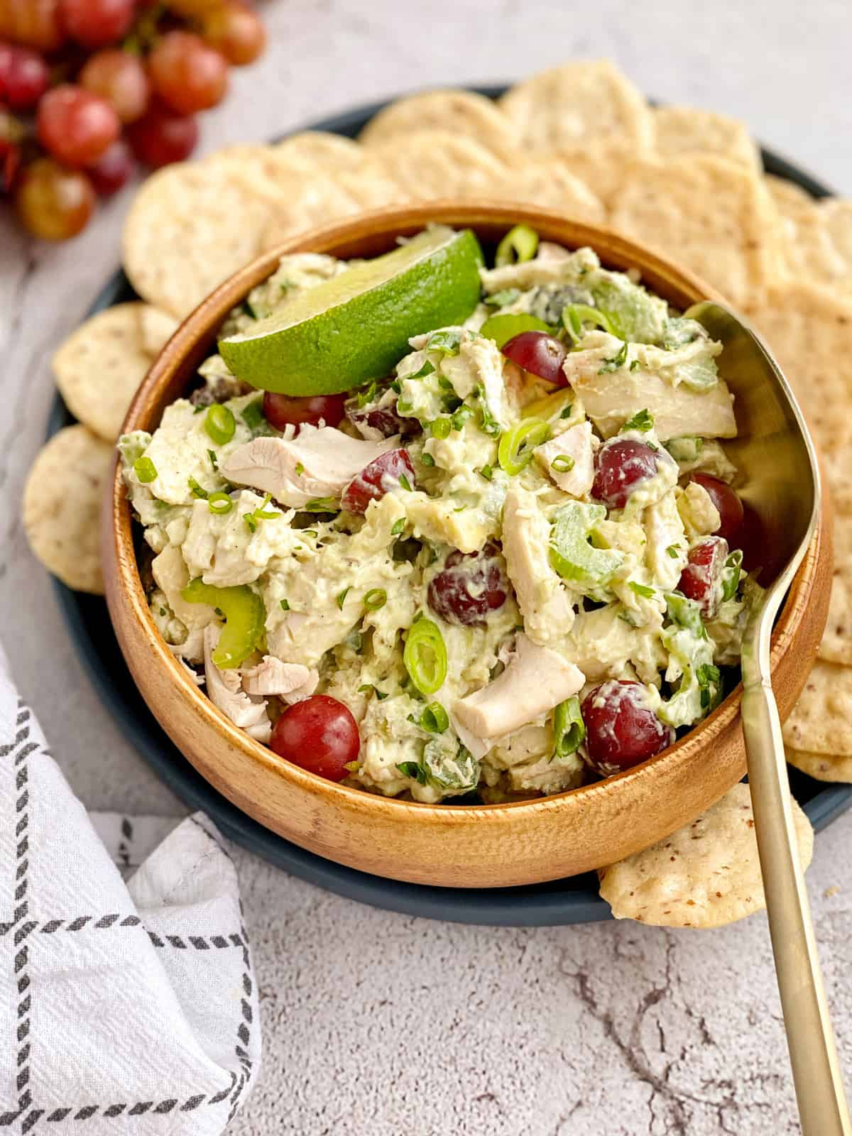 bowl of chicken salad with chips