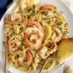 plate of shrimp scampi with toast